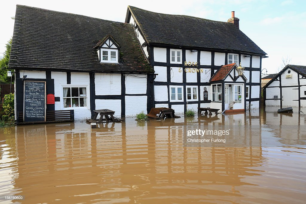 The Rose and Crown public house suffers flooding in the village of Severn Stoke near Worcester on December 27, 2012 in Worcester, England. 2012 could be the UK's wettest year on record according to forecasters and there are currently 88 flood warnings and 207 flood alerts in England and Wales. The Environment Agency in Hereford and Worcestershire are expecting further heavy rain, delaying a clean up until after the weekend.