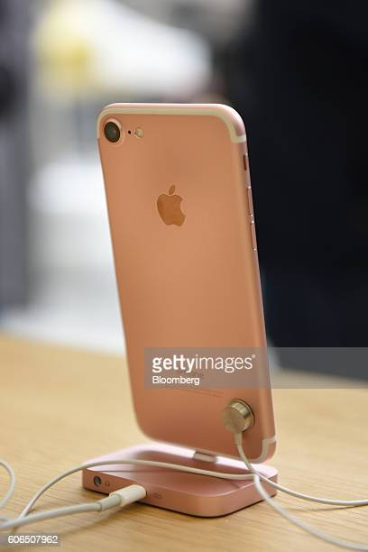 The Rose Gold iPhone 7 smartphone is displayed at an Apple Inc in San Francisco California US on Friday Sept 16 2016 Shoppers looking to buy Apple...