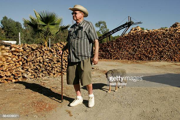 –The Rosenbaum Ranch sells firewood and fresh produce Mel Rosenbaum walks the grounds with his faithful dog Chili near one of the huge firwewood...