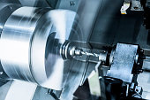 The rotating lathe spindle. Operation of drilling of a detail is made.