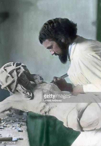 The roughly carved figure handle is then worked out with the carving knife and other objects to an ornate wooden sculpture of the crucified Christ Be...