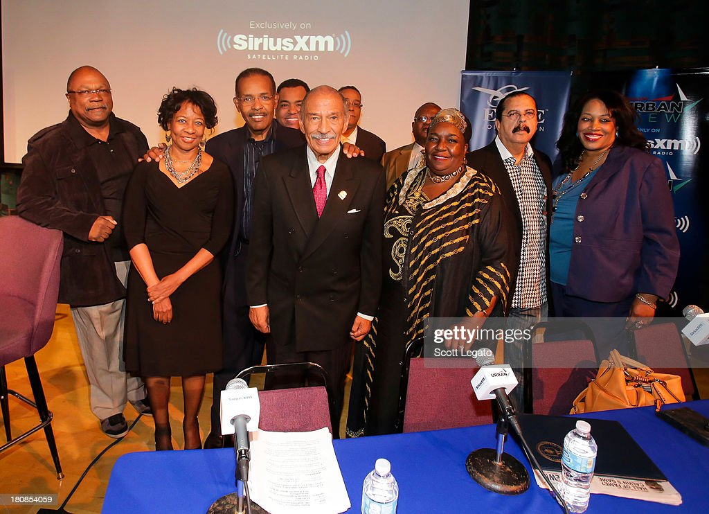 The round table members pose at Charles H. Wright Museum of African American History on September 16, 2013 in Detroit, Michigan.