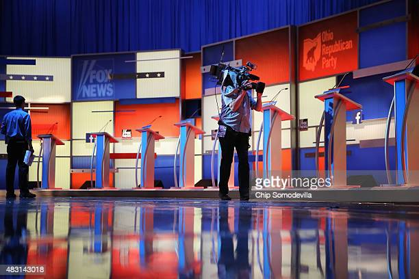 The row of ten podiums for the Republican presidential debate is set on stage at The Quicken Loans Arena August 6 2015 in Cleveland Ohio This is the...