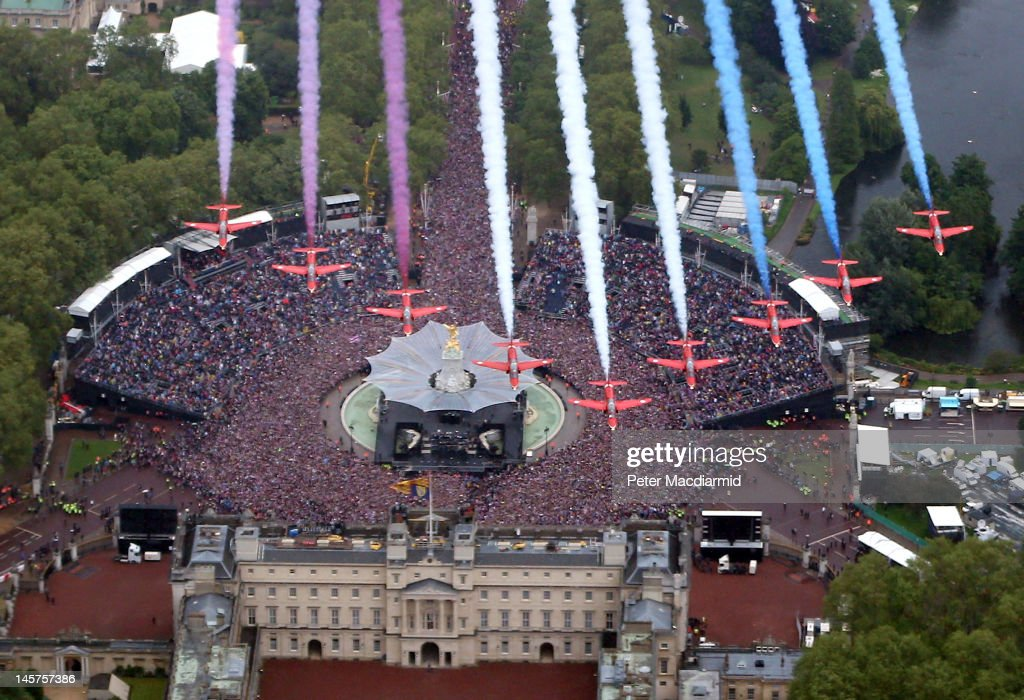 The Royal Air Force Aerobatic Team fly in formation over Buckingham Palace as The Royal family stand on the balcony on June 5, 2012 in London, England. For only the second time in its history the UK celebrates the Diamond Jubilee of a monarch. Her Majesty Queen Elizabeth II celebrates the 60th anniversary of her ascension to the throne. Thousands of wellwishers from around the world have flocked to London to witness the spectacle of the weekend's celebrations.