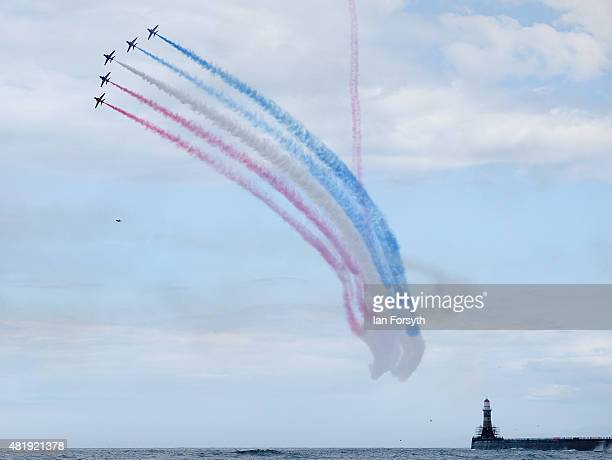 The Royal Air Force Red Arrows fly over the lighthouse at Seaburn as they entertain crowds during the Sunderland International Air Show on July 25...