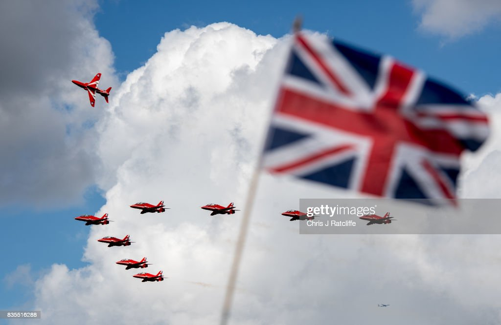 The Royal Air Force Red Arrows fly past a Union Jack whilst departing for another air show at the Biggin Hill Festival of Flight on August 19, 2017 in Biggin Hill, England. The Biggin Hill Festival of Flight is an annual airshow event and in 2017 the airport is celebrating its centenary. The airport only became exclusively business and general aviation in 1959, prior to which it was used by the British Royal Air Force.