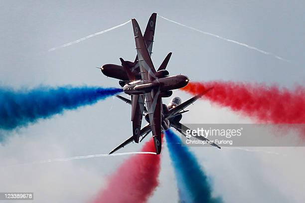 The Royal Air Force Red Arrows perform the 'Gypo Split' during their first public aerobatic display since the tragic death of Flt Lt Jon Egging on...