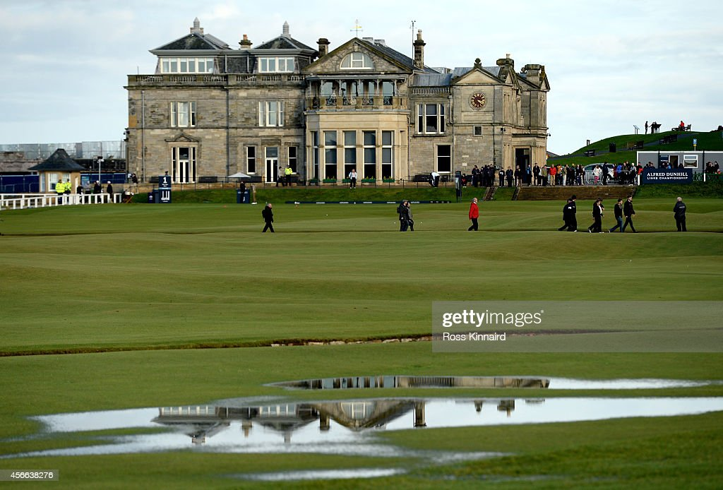 The Royal and Ancient clubhouse reflects in the surface water on the 18th hole during the third round of the 2014 Alfred Dunhill Links Championship...