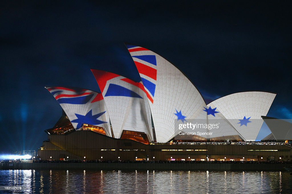 The Royal Australian Navy Ensign flag is displayed on the Sydney Opera House during the International Fleet Review on October 5, 2013 in Sydney, Australia. Over 50 ships participate in the International Fleet Review at Sydney Harbour to commemorate the 100 year anniversary of the Royal Australian Navy's fleet arriving into Sydney. Prince Harry is an official guest of the Australian Government and will take part in the fleet review during his two-day visit to Australia.