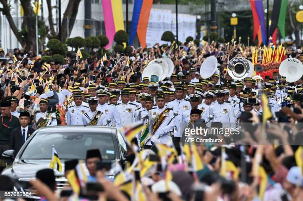 The Royal band marches ahead of Brunei's Sultan Hassanal Bolkiah and Queen Saleha royal chariot during a procession to mark his golden jubilee of...
