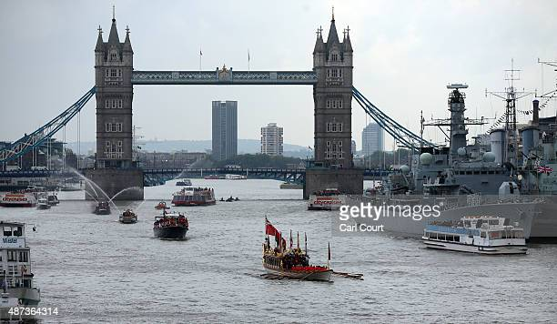 The Royal Barge Gloriana leads a procession along the River Thames near Tower Bridge and HMS Belfast to pay tribute to Queen Elizabeth II becoming...