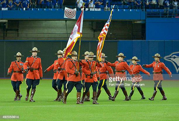 The Royal Canadian Mounted Police Color Guard during the opening ceremony before the Toronto Blue Jays welcome the Texas Rangers for Game 2 of the...