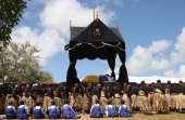 The Royal casket of King George Tupou V is carried towards the Royal Tombs during the State Funeral held for King George Tupou V at Mala'ekula on...