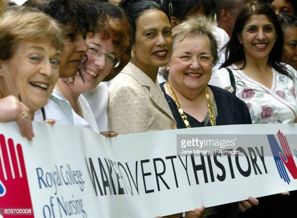 The Royal College of Nursing General Secretary Beverly Malone assembles alongside scores of nurses in London's Cavendish Square inside a giant...