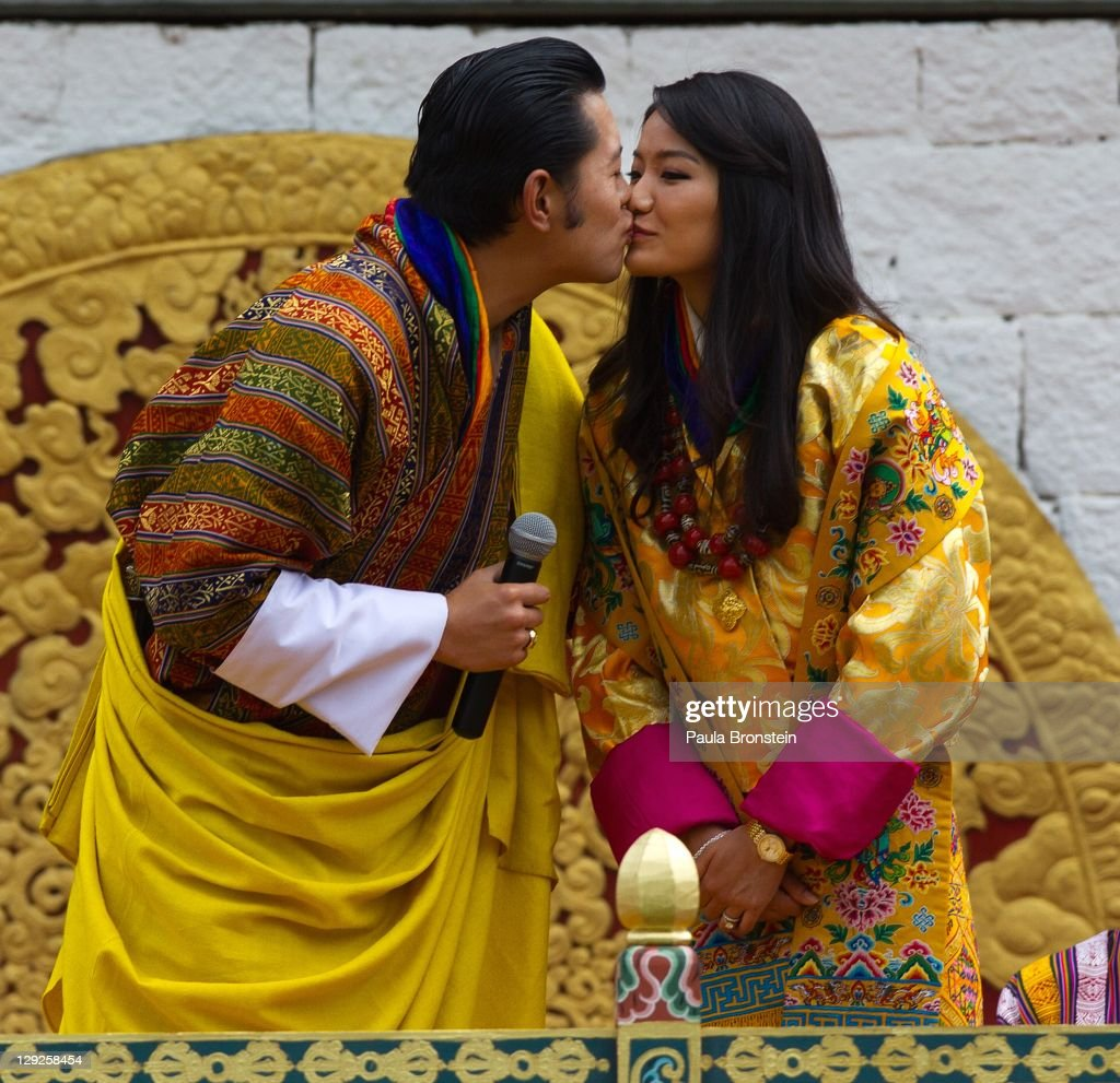 The Royal couple King <a gi-track='captionPersonalityLinkClicked' href=/galleries/search?phrase=Jigme+Khesar+Namgyel+Wangchuck&family=editorial&specificpeople=737466 ng-click='$event.stopPropagation()'>Jigme Khesar Namgyel Wangchuck</a> and Queen of Bhutan Ashi Jetsun Pema Wangchuck kiss in front of thousands of Bhutanese citizens at the celebration ground at ChangLeme Thang on October 15, 2011 in Thimphu, Bhutan. Today marked the third and final day of celebrations for the royal wedding with singing and dancing.