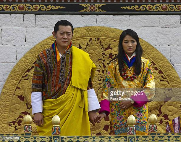 The Royal couple King Jigme Khesar Namgyel Wangchuck stands with his new bride Queen of Bhutan Ashi Jetsun Pema Wangchuck stand in front of a crowd...