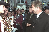 The royal couple meet the 'prince' of St Vith carnaval and his maids of honour