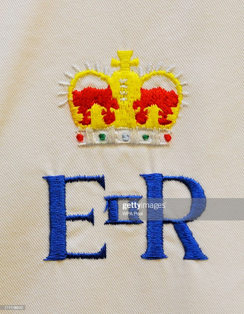 The Royal Crest on the chef whites of staff working in the kitchens is seen at Buckingham Palace on March 25, 2011 in London, England. Prince Prince William will marry his long term girlfriend Kate Middleton on April 29, 2011 at Westminster Abbey and it was reported that the couple had chosen two Wedding cakes for their big day - a 'multi-tiered traditional fruit case with a floral design and a chocolate biscuit cake.'