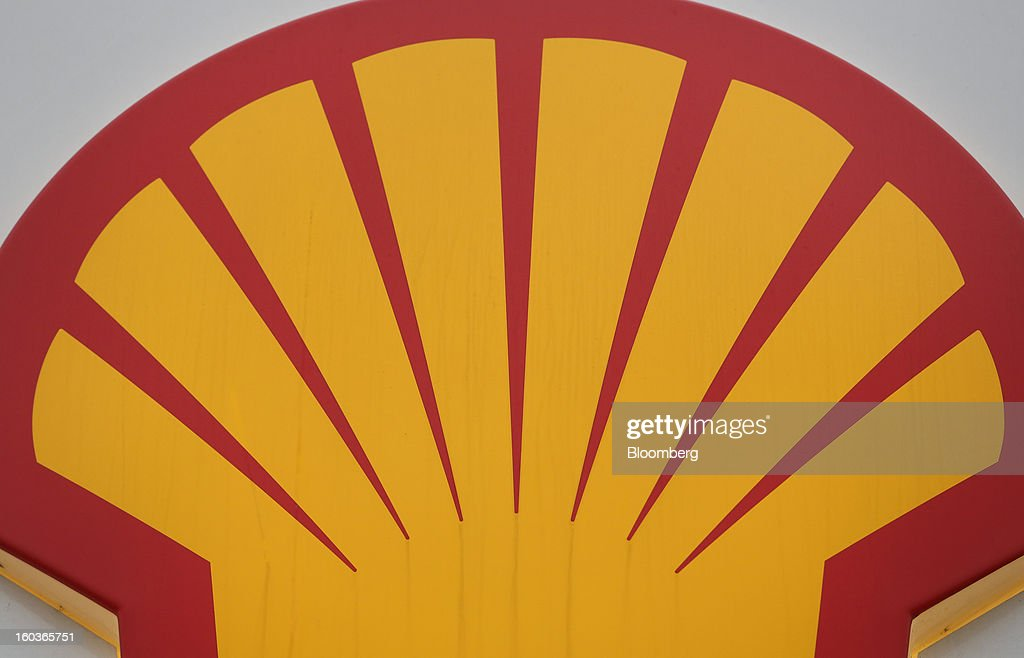 The Royal Dutch Shell Plc company logo is seen above the entrance to a gas station in London, U.K., on Tuesday, Jan. 29, 2013. Oil traded near the highest level in four months ahead of a Federal Reserve policy statement that may signal the U.S. central bank will take additional steps to stimulate the economy. Photographer: Chris Ratcliffe/Bloomberg via Getty Images