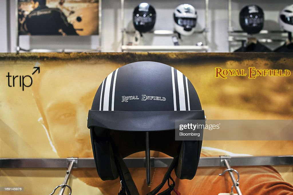 The Royal Enfield logo is displayed on a motorcycle helmet on display at the Eicher Motors Ltd. Royal Enfield flagship dealership in Gurgaon, India, on Monday, May 20, 2013. The Indian maker of Royal Enfield, the World War II-era British motorcycle owned by stars including Brad Pitt, plans to export the vehicles to Southeast Asia and Latin America as it builds on record sales at home. Photographer: Prashanth Vishwanathan/Bloomberg via Getty Images