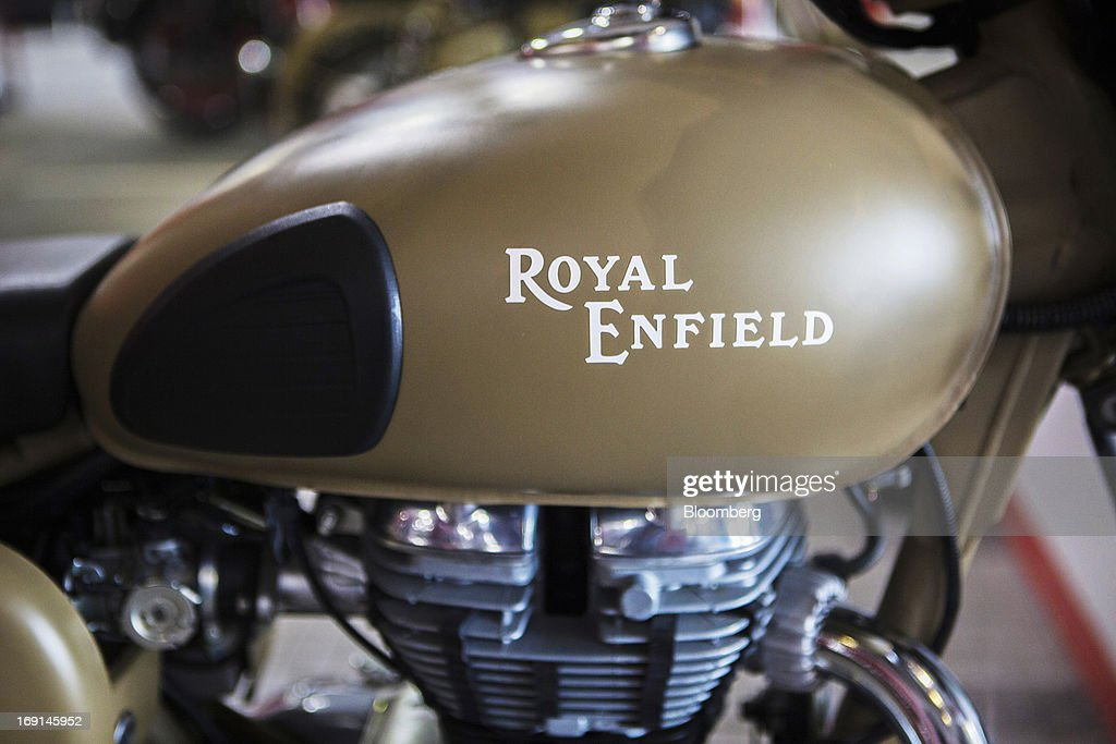 The Royal Enfield logo is displayed on the gas tank of a Desert Storm motorcycle on display at the Eicher Motors Ltd. Royal Enfield flagship dealership in Gurgaon, India, on Monday, May 20, 2013. The Indian maker of Royal Enfield, the World War II-era British motorcycle owned by stars including Brad Pitt, plans to export the vehicles to Southeast Asia and Latin America as it builds on record sales at home. Photographer: Prashanth Vishwanathan/Bloomberg via Getty Images