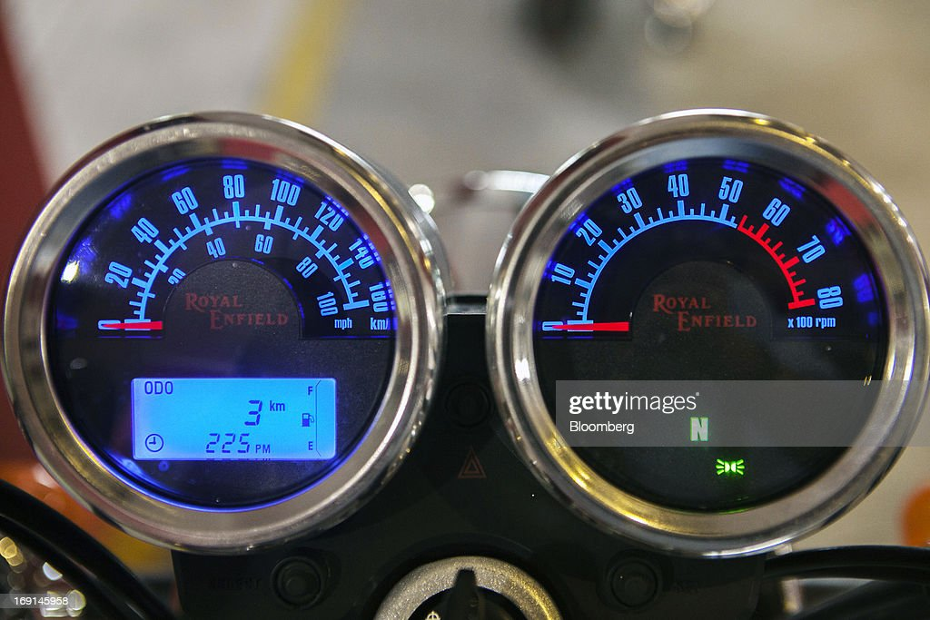 The Royal Enfield logo is displayed on the speedometer and rev counter of a Thunderbird motorcycle on display at the Eicher Motors Ltd. Royal Enfield flagship dealership in Gurgaon, India, on Monday, May 20, 2013. The Indian maker of Royal Enfield, the World War II-era British motorcycle owned by stars including Brad Pitt, plans to export the vehicles to Southeast Asia and Latin America as it builds on record sales at home. Photographer: Prashanth Vishwanathan/Bloomberg via Getty Images