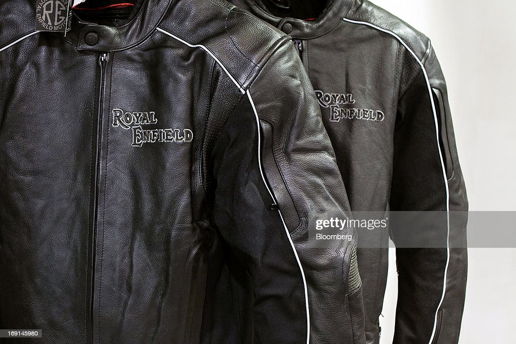 The Royal Enfield logo is imprinted on leather motorcycle jackets on display at the Eicher Motors Ltd. Royal Enfield flagship dealership in Gurgaon, India, on Monday, May 20, 2013. The Indian maker of Royal Enfield, the World War II-era British motorcycle owned by stars including Brad Pitt, plans to export the vehicles to Southeast Asia and Latin America as it builds on record sales at home. Photographer: Prashanth Vishwanathan/Bloomberg via Getty Images