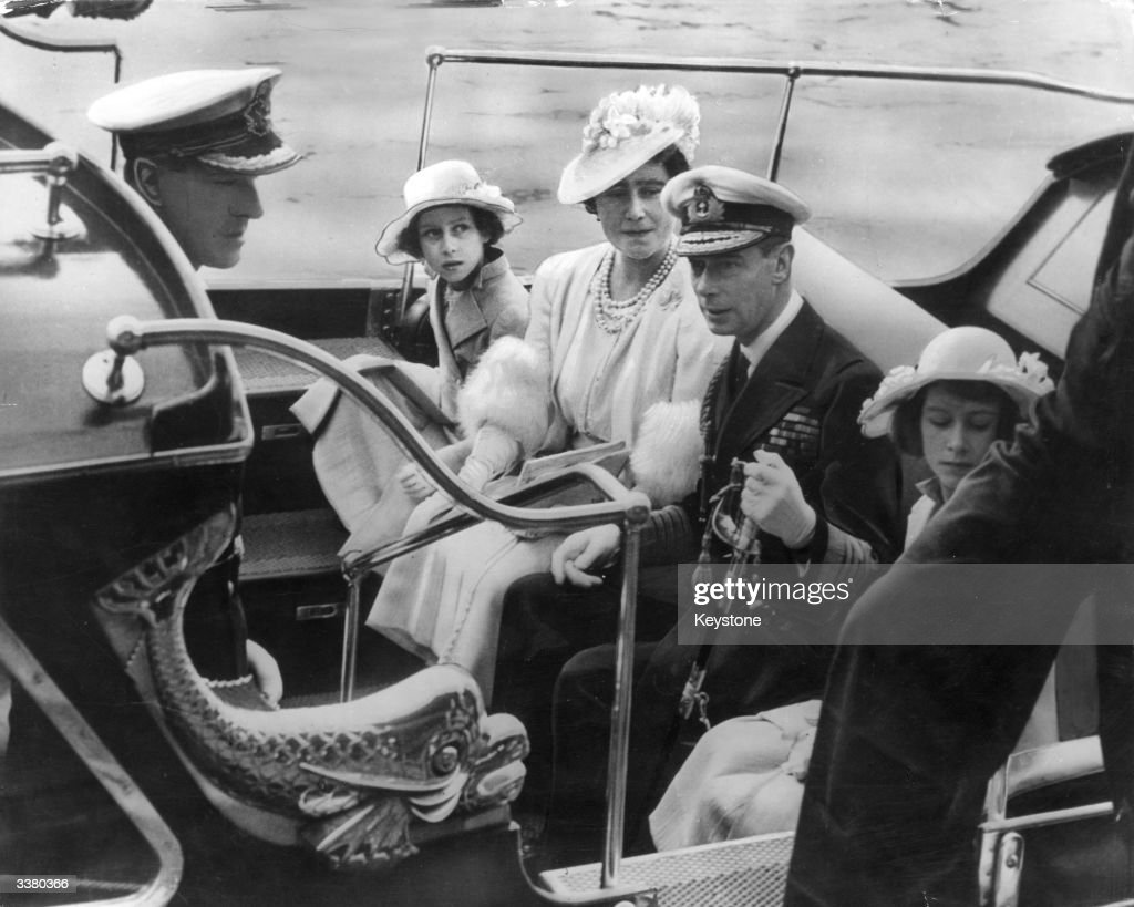 The royal family arriving at the Royal Naval College in Dartmouth. L-R are Prince Philip of Greece, Princess Margaret (1930 - 2002), Queen Elizabeth, King George VI (1895 - 1952) and Princess Elizabeth.