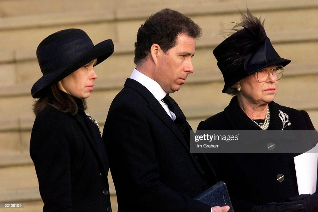 The Royal Family Attending The Funeral Of Princess Margaret At St. George's Chapel In Windsor Castle. Lady Sarah Chatto With Her Brother Lord Linley (viscount David Linley) And Their Aunt, Queen Elizabeth II Watching As Their Mother's Coffin Leaves For Cremation. Wearing Black For Mourning And Showing Their Grief With Sad Expressions.