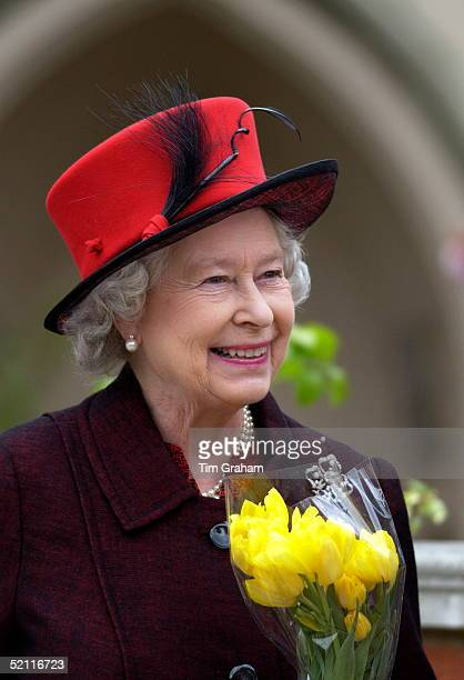 The Royal Family Gathered For Easter Service At Windsor Castle Queen Elizabeth II Happy And Smiling In Her Easter Bonnet Hat Holding Spring Flowers...