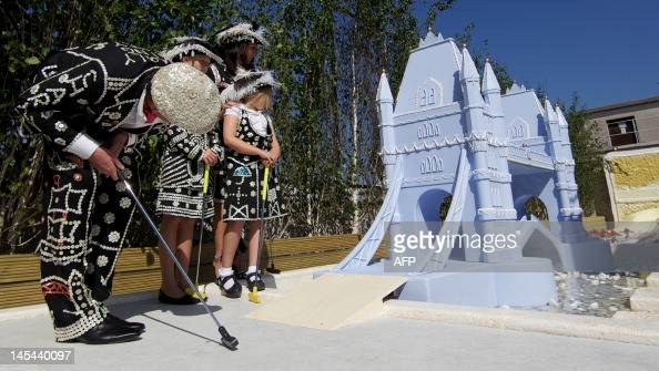 The Royal Family of the Pearly King and Queen of the City of London Stewart and Vanessa Vallely and their daughters play crazy golf on the roof top...
