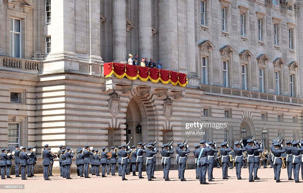 The royal family watch a Feu de Joie given by the Old and New Guards found by The Queen's Colour Squadron, Royal Air Force, from the balcony of Buckingham Palace after an RAF fly-past to commemorate 75th Anniversary Of The Battle Of Britain on July 10, 2015 in London, England.