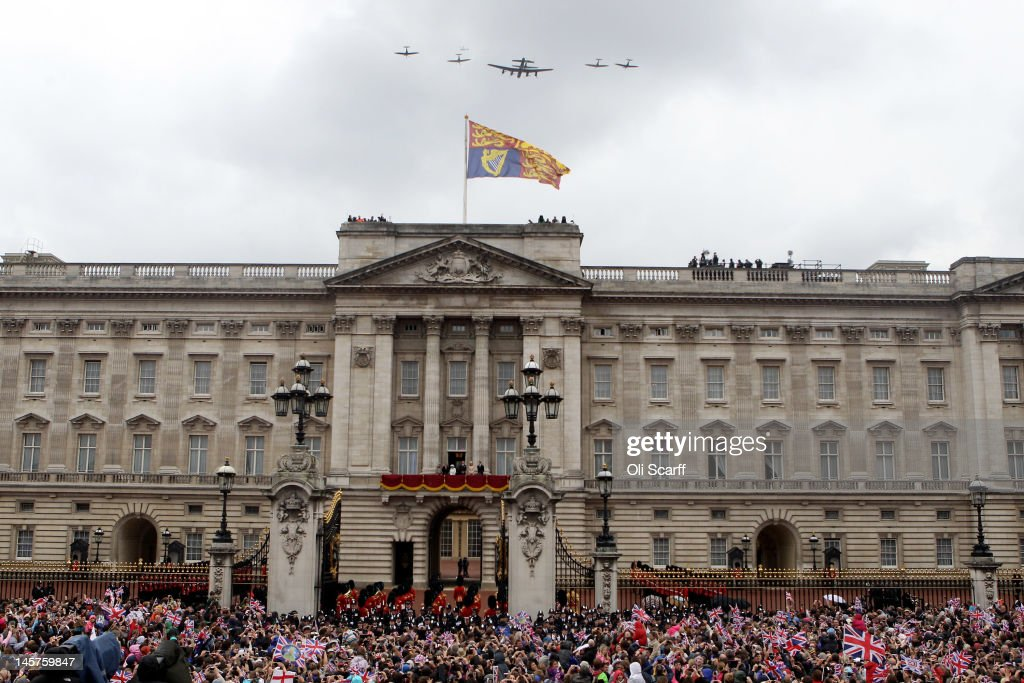The Royal family watch from the balcony of Buckingham Palace as Lancaster Spitfire and Hurricane aircraft take part in a RAF fly past after the service of thanksgiving at St.Paul's Cathedral on June 5, 2012 in London, England. For only the second time in its history the UK celebrates the Diamond Jubilee of a monarch. Her Majesty Queen Elizabeth II celebrates the 60th anniversary of her ascension to the throne. Thousands of wellwishers from around the world have flocked to London to witness the spectacle of the weekend's celebrations.