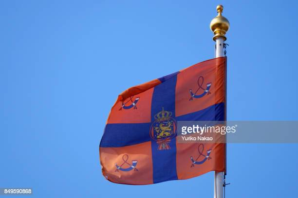 The royal flag or the royal standard of the Netherlands flutters atop the Palace Noordeinde during the Prinsjesdag the openingday of Dutch parliament...