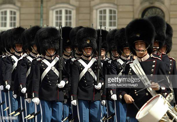 The Royal Guard parade during the changing of guards at Copenhagen's Amalienborg Palace 13 May 2004 on the eve of the wedding of Danish Crown Prince...
