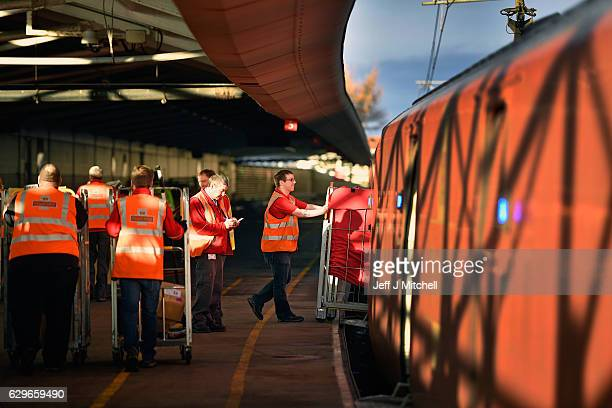 The Royal Mail train is unloaded by workers at the Scottish Distribution Centre before travelling south on December 14 2016 in Wishaw Scotland In the...