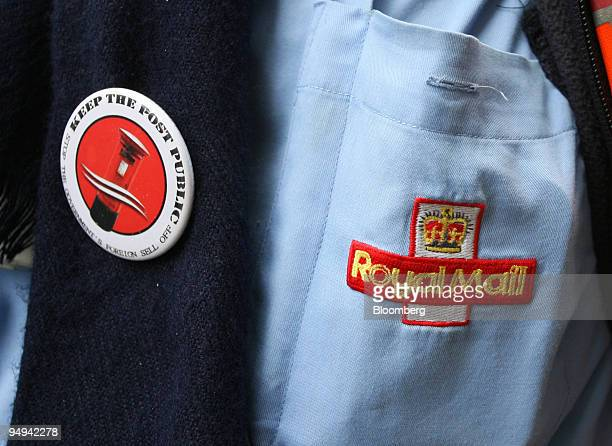 The Royal Mail's logo is displayed on the uniform of an employee at a protest meeting in London UK on Tuesday Feb 24 2009 Royal Mail Group Plcs...
