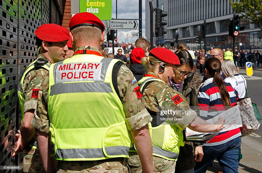 The Royal Military Police assist with policing during the Babcock Trophy rugby union match between The British Army and the Royal Navy played in Twickenham Stadium, on April 30, 2016 in Twickenham, England.