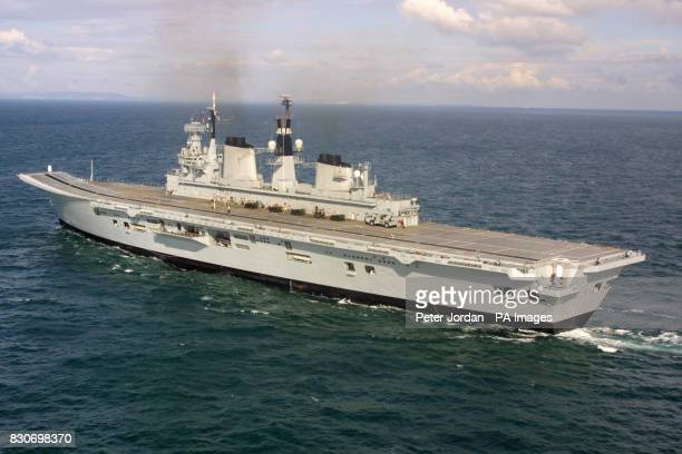 The Royal Navy aircraft carrier HMS Ark Royal sails into Portsmouth harbour after a two year major refit in Rosyth Scotland The Ark Royal which will...