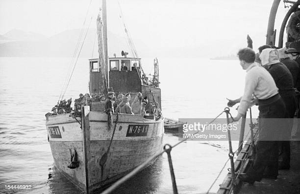 The Royal Navy During The Second World War A boat load of Royal Engineers leaves HMS CAIRO on board a Motor Fishing Vessel to land in Narvik June 1940