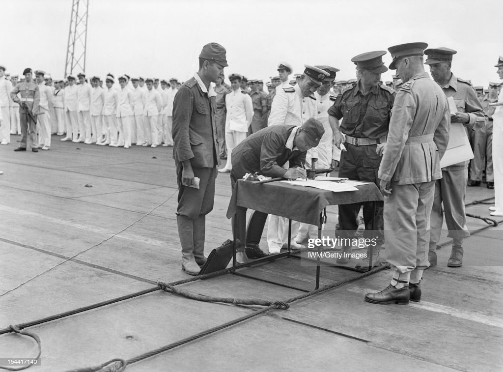 The Royal Navy During The Second World War, General Imamura, Japanese South-Eastern Army Chief, signing the official document for the surrender of 139,000 Japanese in New Britain, New Ireland, the Solomons and New Guinea. The surrender ceremony took place on the flight deck of HMS GLORY off Rabaul. Lieutenant General Sturdee, GOC First Australian Army, who signed for the Allies, is closely watching the Japanese General from the other side of the table. Admiral Jin Icha Kusaka signed the treaty for the Japanese south eastern naval forces, 12 September 1945.