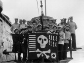 The Royal Navy During The Second World War Members of the crew of HMS UTMOST with their 'Jolly Roger' success flag photographed alongside HMS FIRTH...
