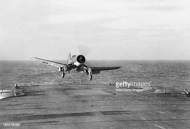 The Royal Navy During The Second World War Throttled back an American built ChanceVought Corsair starts to sink to the deck of HMS ILLUSTRIOUS prior...