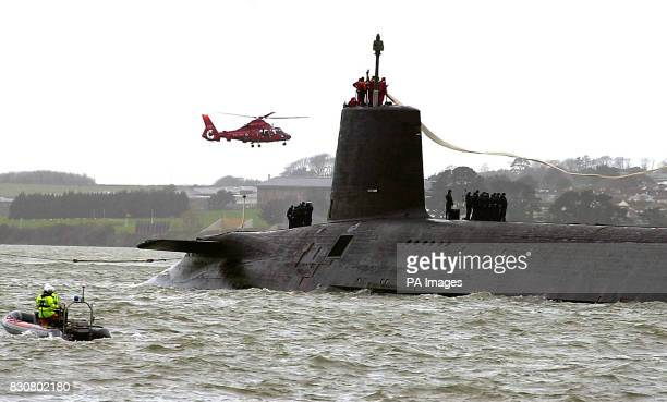 The Royal Navy nuclear submarine HMS Vanguard arrives at Devonport naval base in Plymouth for refit HMS Vanguard is 150 metres long and displaces...