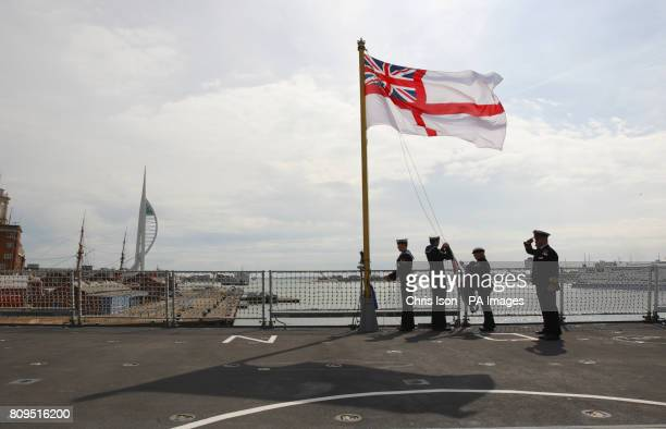 The Royal Navy's newest warship the Type 45 Destroyer HMS Dragon flies the white ensign for the first time as she is handed over to the Royal Navy...