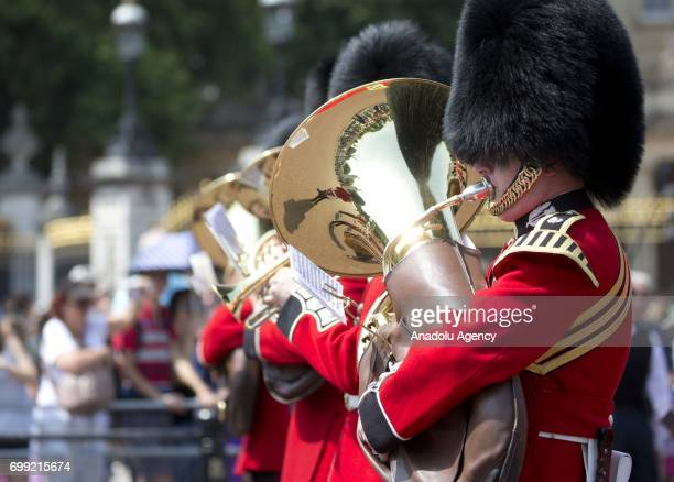 The Royal Palace guard marching band is seen outside Buckingham Palace ahead of the departure of Britain's Queen Elizabeth II to the Houses of...
