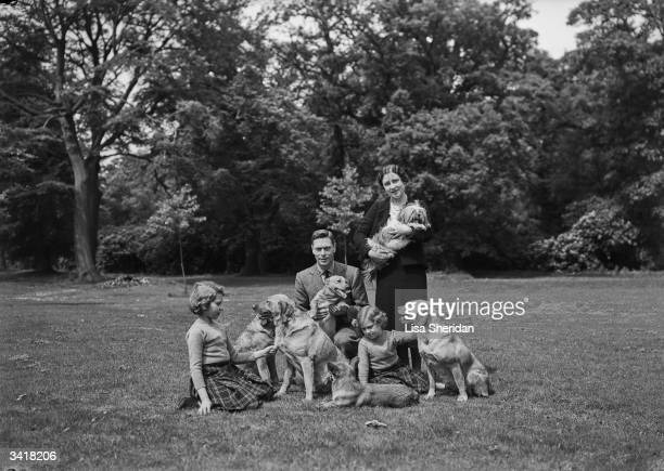 The Royal family with their dogs in the grounds of the Royal Lodge Windsor Queen Elizabeth Princess Elizabeth King George VI and Princess Margaret...