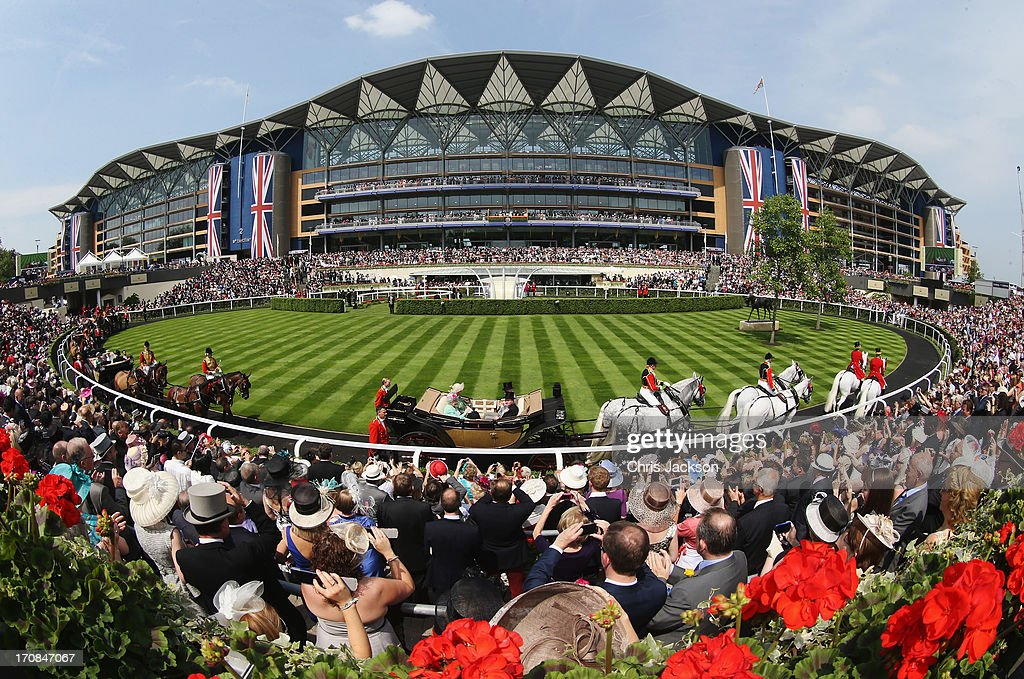 The Royal Procession passes around the Parade Ring in front of the Main Grandstand on day two of Royal Ascot at Ascot Racecourse on June 19, 2013 in Ascot, England.