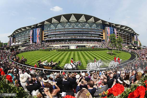 The Royal Procession passes around the Parade Ring in front of the Main Grandstand on day two of Royal Ascot at Ascot Racecourse on June 19 2013 in...