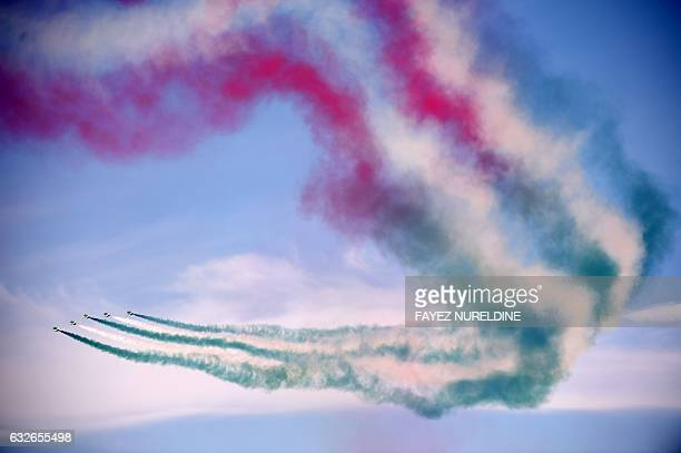 TOPSHOT The Royal Saudi Hawks the aerobatic team of the Royal Saudi Air Force performs during a ceremony marking the 50th anniversary of the creation...
